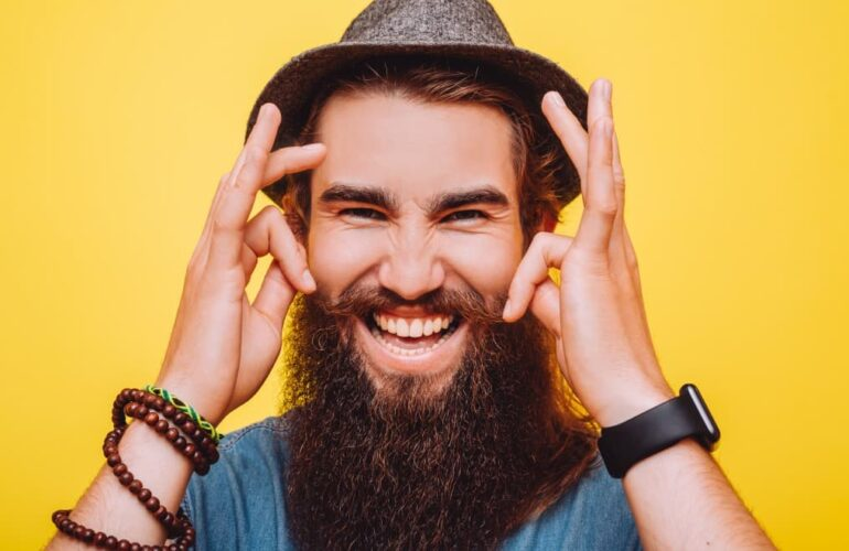 Smiling man with a beard